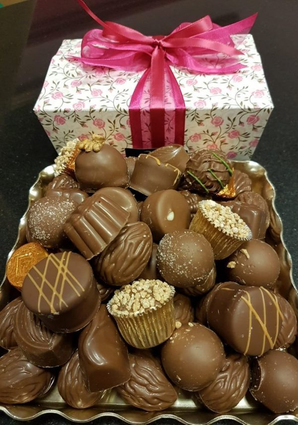 A picture of Chocol8's Milk Belgian Chocolate selection with a floral pink and white gift box